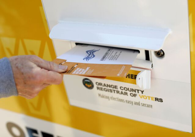 A voter drops ballots for the March 3 Super Tuesday primary into a mobile voting mail box in Laguna Woods, California, U.S., February 24, 2020. Picture taken February 24, 2020.