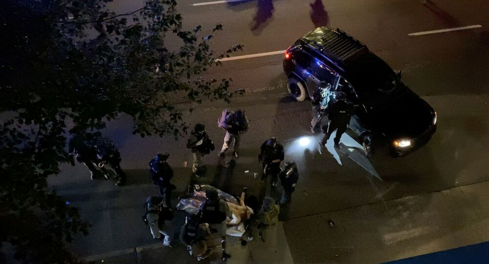 SENSITIVE MATERIAL. THIS IMAGE MAY OFFEND OR DISTURB    Medics and police personnel surround the victim of a shooting in Portland, Oregon, U.S. August 29, 2020, in this still image obtained from a social media video. Courtesy of Sergio Olmos/Social Media via REUTERS. ATTENTION EDITORS - THIS IMAGE HAS BEEN SUPPLIED BY A THIRD PARTY. MANDATORY CREDIT SERGIO OLMOS. NO RESALES. NO ARCHIVES.