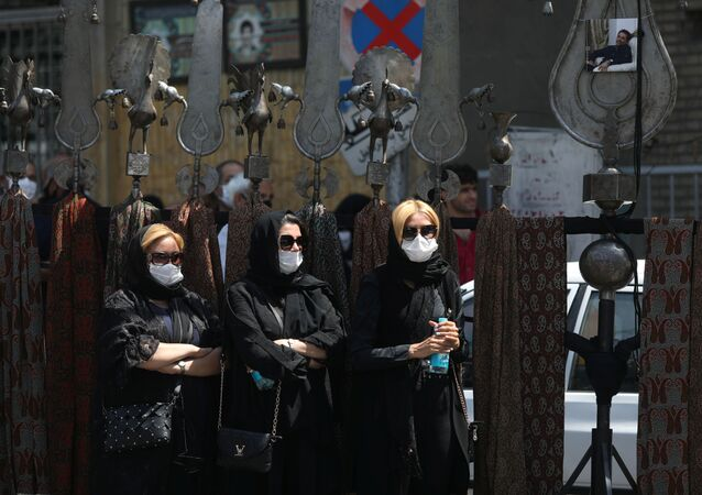 Iranian women wearing protective masks take part in a mourning ceremony ahead of Ashura, the holiest day on the Shi'ite Muslim calendar, amid the spread of the coronavirus disease (COVID-19), in Tehran, Iran August 29, 2020.