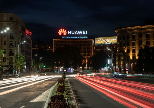 Cars drive past a Huawei logo on a building in central Belgrade, Serbia, August 11, 2020. Picture taken August 11, 2020. Picture taken with a long exposure