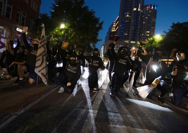 Black Lives Matter protesters block Congress Avenue at a march in Austin, Texas, U.S., August 1, 2020. Members of the Boogaloo Boys and the Texas Guerrillas also appeared at the rally saying they wanted to protect protesters and their right to free speech. Picture taken August 1, 2020