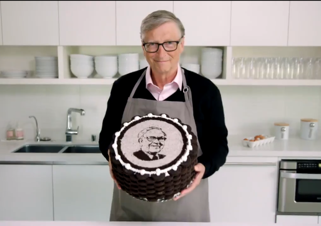 Screenshot from a video showing Bill Gates baking a cake for William Buffet