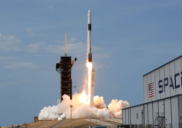 A SpaceX Falcon 9 rocket and Crew Dragon spacecraft carrying NASA astronauts Douglas Hurley and Robert Behnken lifts off during NASA's SpaceX Demo-2 mission to the International Space Station from NASA's Kennedy Space Center in Cape Canaveral, Florida, U.S., May 30, 2020.