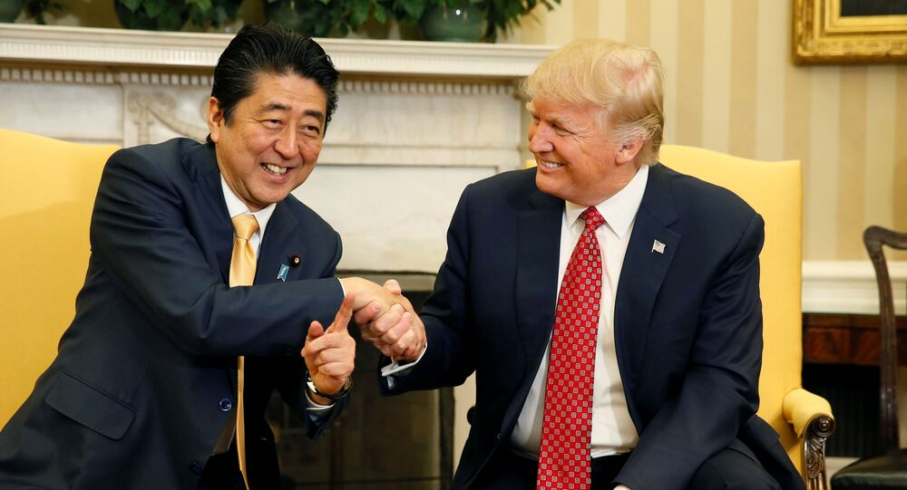 Japanese Prime Minister Shinzo Abe shakes hands with U.S. President Donald Trump (R) during their meeting in the Oval Office at the White House in Washington, U.S., February 10, 2017.