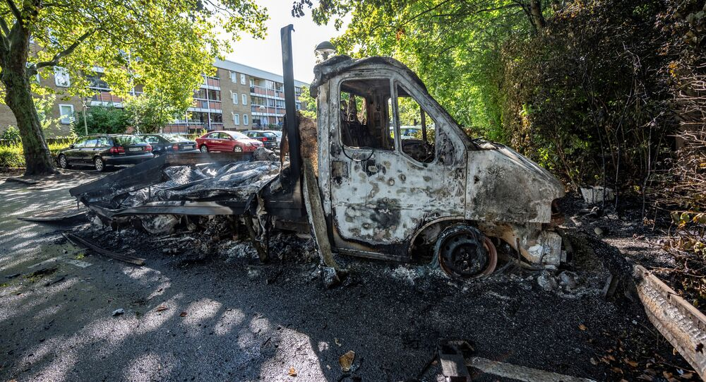 A burnt-out light truck is seen in Rosengard after Friday's night of riots, in Malmo, Sweden, 29 August 2020