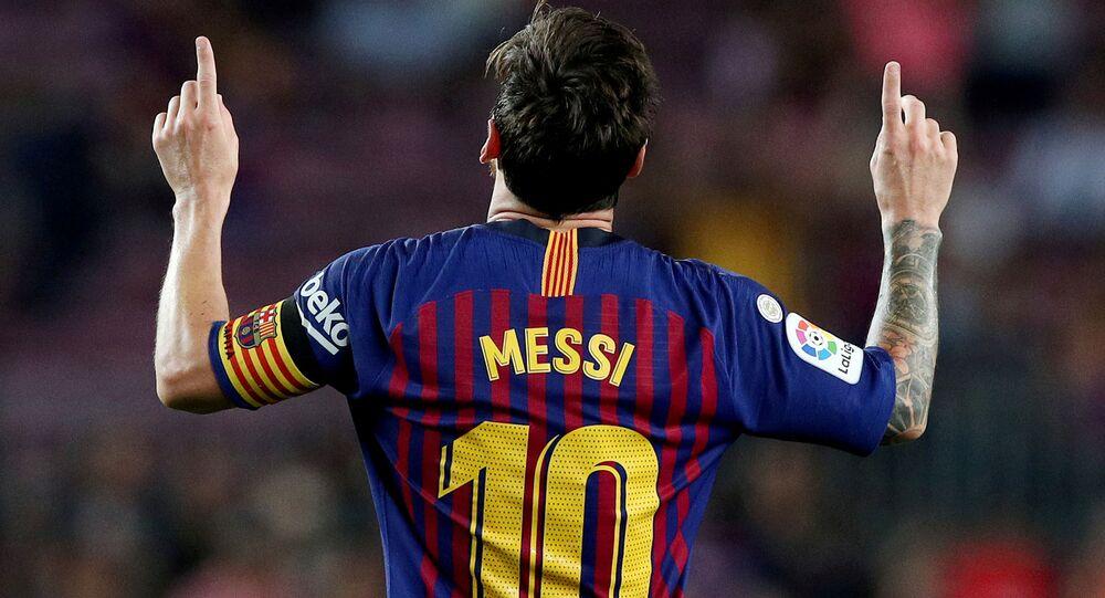 Barcelona's Lionel Messi celebrates scoring their third goal. 18 August 2018