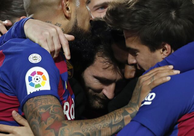 Barcelona's Lionel Messi, center, celebrates after scoring the opening goal during a Spanish La Liga soccer match between Barcelona and Granada at Camp Nou stadium in Barcelona, Spain, Sunday, Jan. 19, 2020.