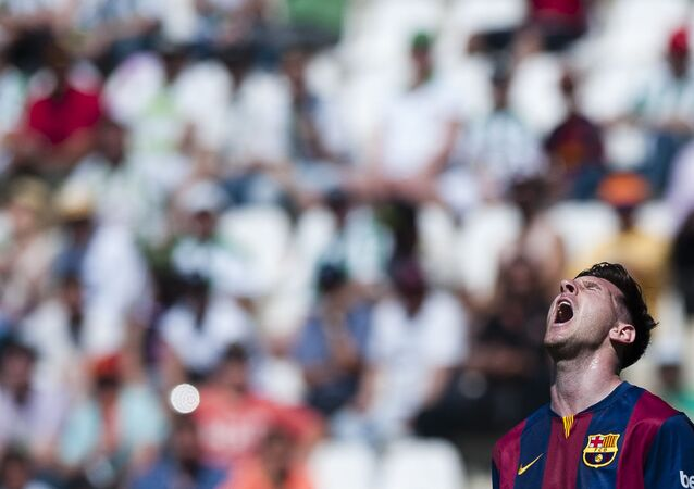 Barcelona's Lionel Messi gestures during a Spanish La Liga soccer match between Cordoba and FC Barcelona at El Arcangel stadium in Cordoba, Spain, Saturday May 2, 2015.