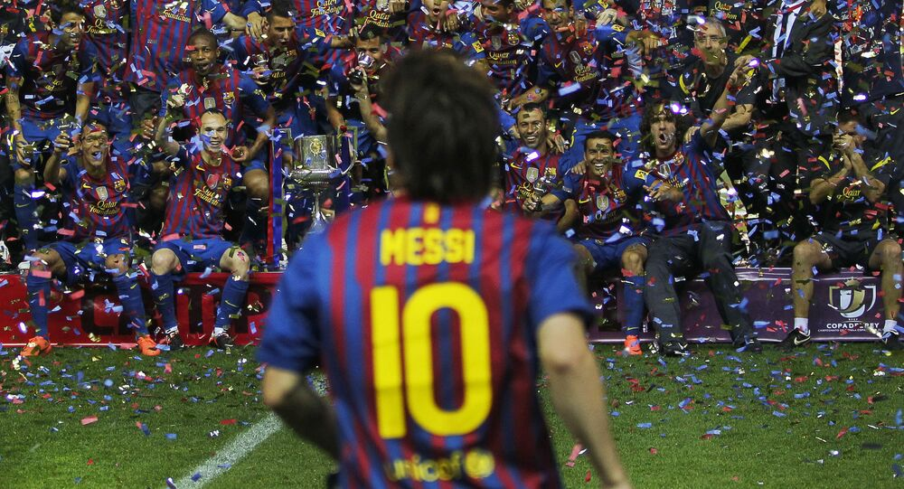 FC Barcelona's Lionel Messi from Argentina, front celebrates with his teammates after the final Copa del Rey soccer match against Athletic Bilbao at the Vicente Calderon stadium in Madrid, Spain, Friday, May 25, 2012.