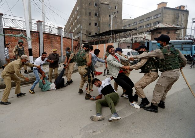 Kashmiri Shi'ite Muslims are detained by Indian police while trying to participate in a Muharram procession, in Srinagar, August 28, 2020