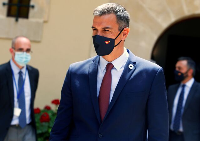 Spain's Prime Minister Pedro Sanchez wears a face mask after his traditional summer meeting with King Felipe at Marivent Palace in Palma de Mallorca, Spain, August 12, 2020.