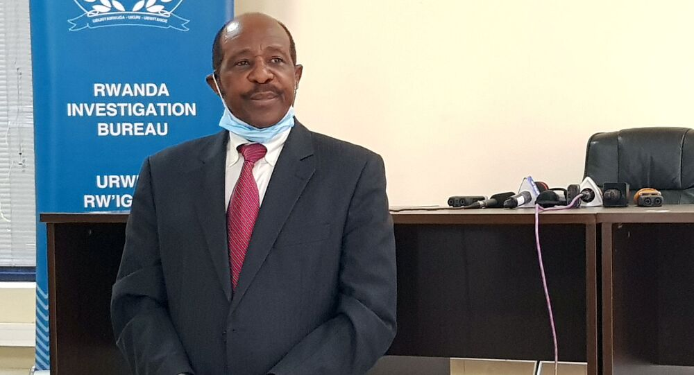 Paul Rusesabagina, the man who was hailed a hero in a Hollywood movie about the country's 1994 genocide is detained and paraded in front of media in handcuffs at the headquarters of Rwanda Investigation Bureau in Kigali, Rwanda August 31, 2020.