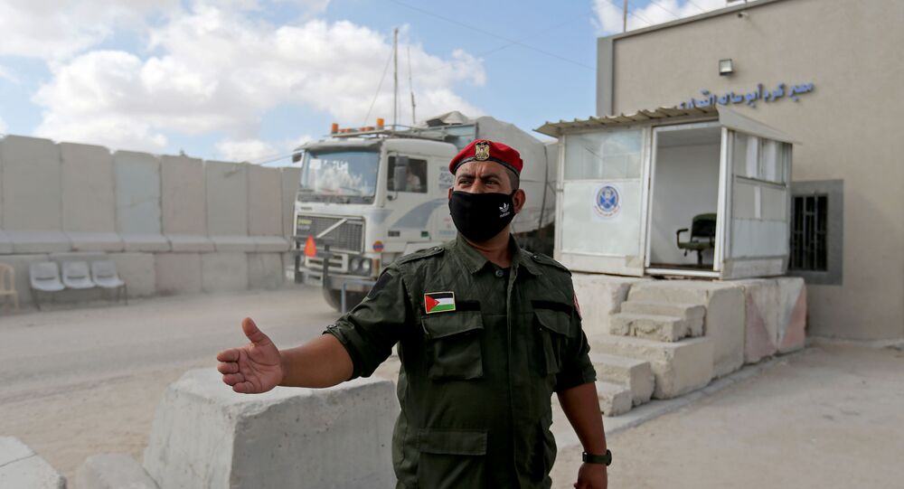 A Palestinian member of Hamas security forces stands outside the main commercial crossing with Gaza, Kerem Shalom, in the southern Gaza strip August 11, 2020.