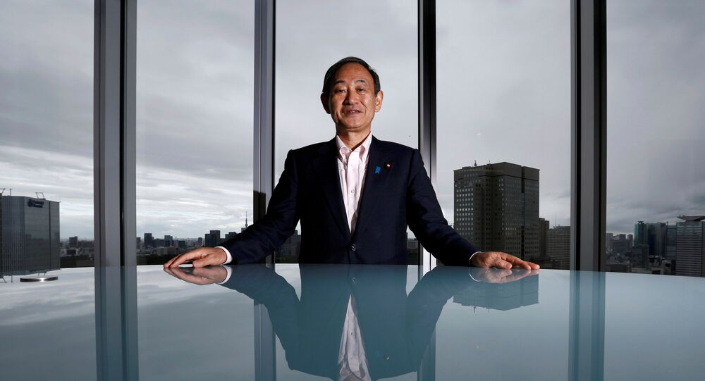 Japan's Chief Cabinet Secretary Yoshihide Suga poses for a photograph during a Thomson Reuters Newsmaker event in Tokyo, Japan, 30 August 2016.