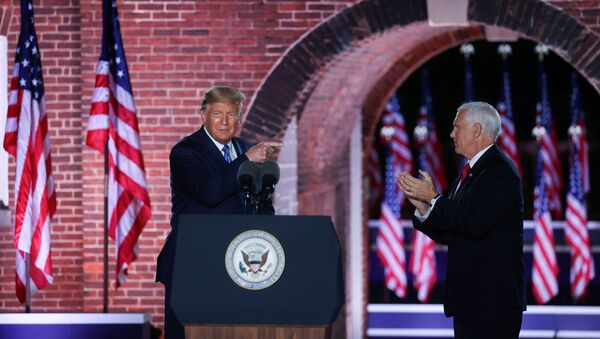 U.S. Vice President Mike Pence is joined onstage by U.S. President Donald Trump after delivering his acceptance speech as the 2020 Republican vice presidential nominee during an event of the 2020 Republican National Convention held at Fort McHenry in Baltimore, Maryland, U.S, August 26, 2020 - Sputnik International