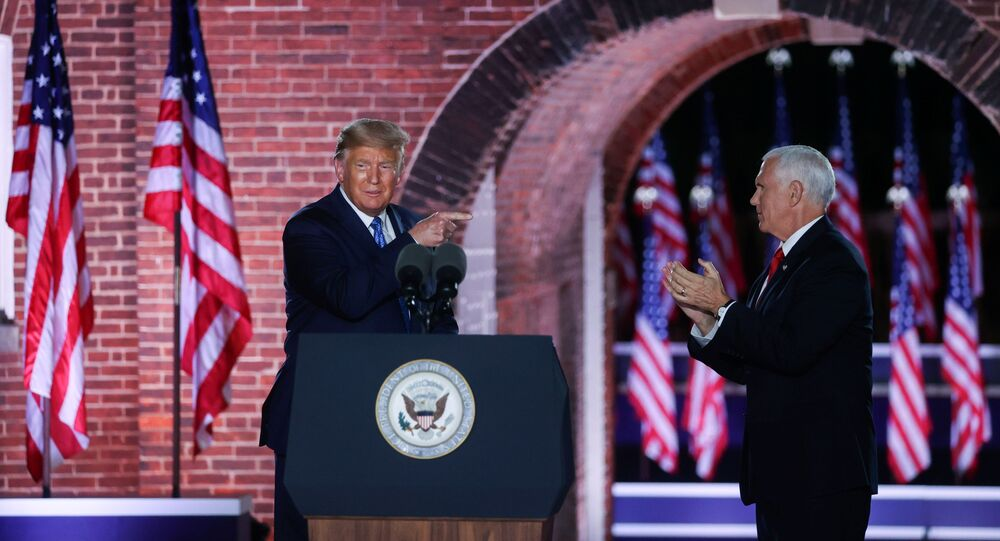 U.S. Vice President Mike Pence is joined onstage by U.S. President Donald Trump after delivering his acceptance speech as the 2020 Republican vice presidential nominee during an event of the 2020 Republican National Convention held at Fort McHenry in Baltimore, Maryland, U.S, August 26, 2020