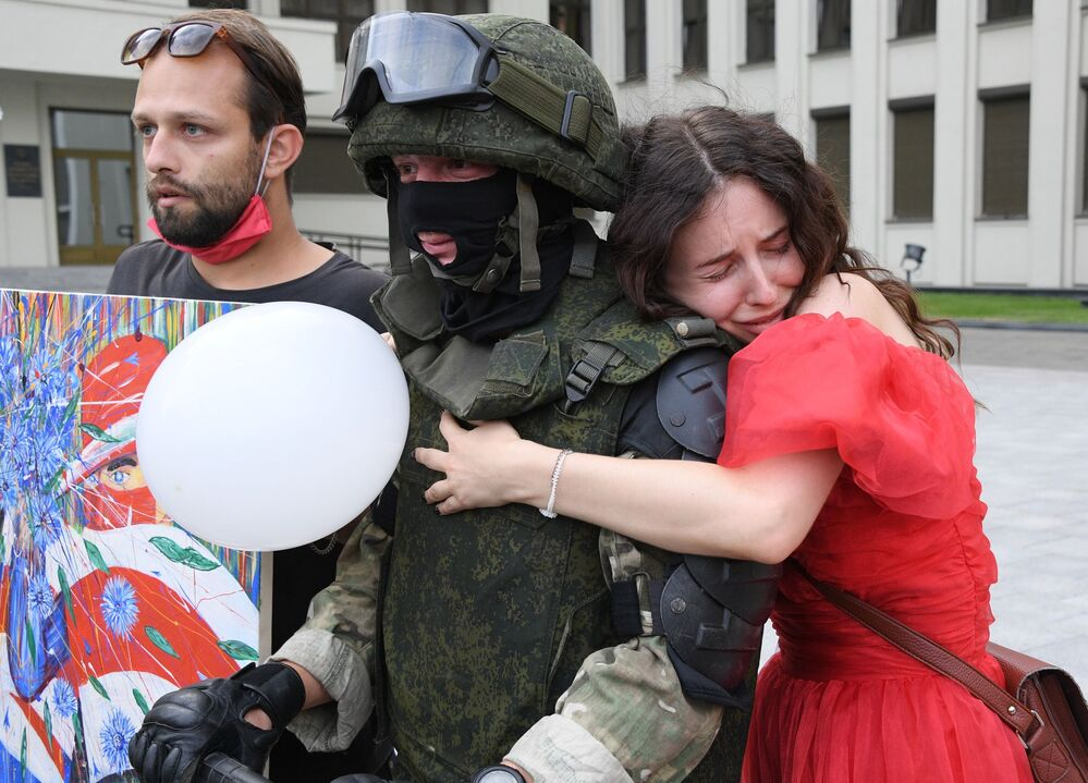 Protesters and a security officer in Minsk, Belarus. 14 August 2020