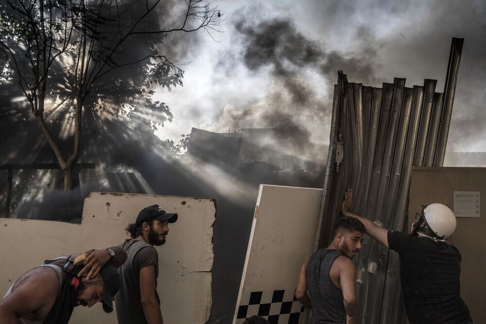 Anti-government protesters clash with riot police in Beirut.