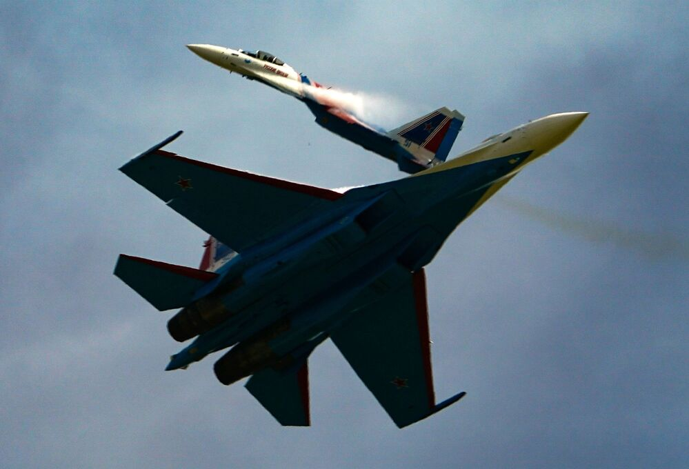 Su-35C jets of the Russian Knights aerobatic team perform a demonstration flight at the Army-2020 forum outside Moscow.