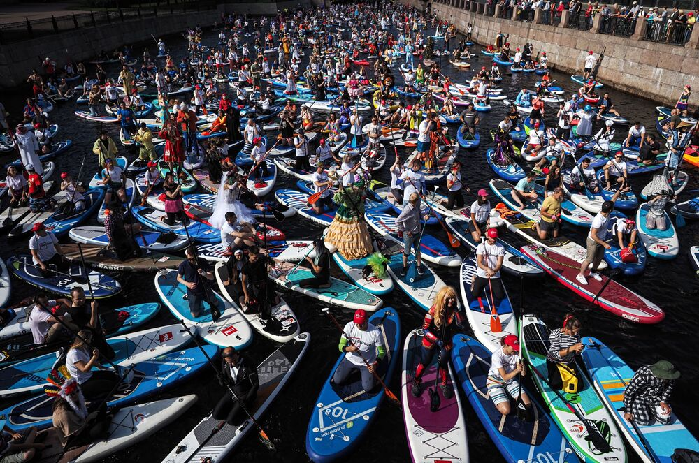 Participants of the international SUP-surfing festival, Fontanka-SUP, in Saint Petersburg.