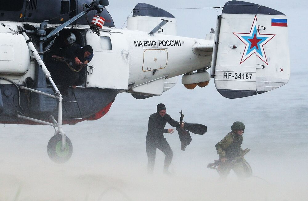 Soldiers of the Russian Baltic Fleet get off a Ka-27 PC helicopter during drills.