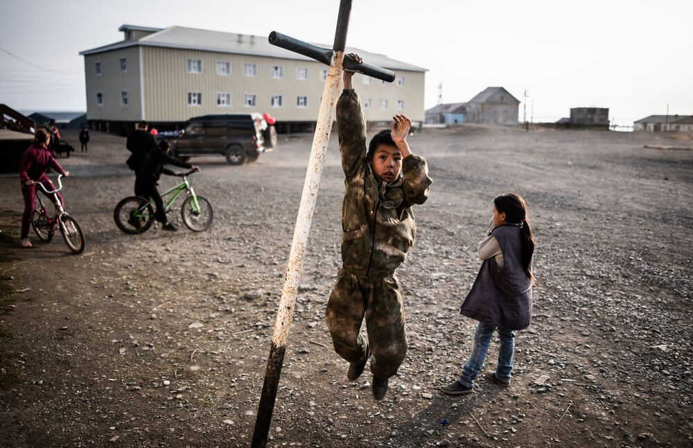 Children play in the street in Lorino village in Russia's Chukotka.