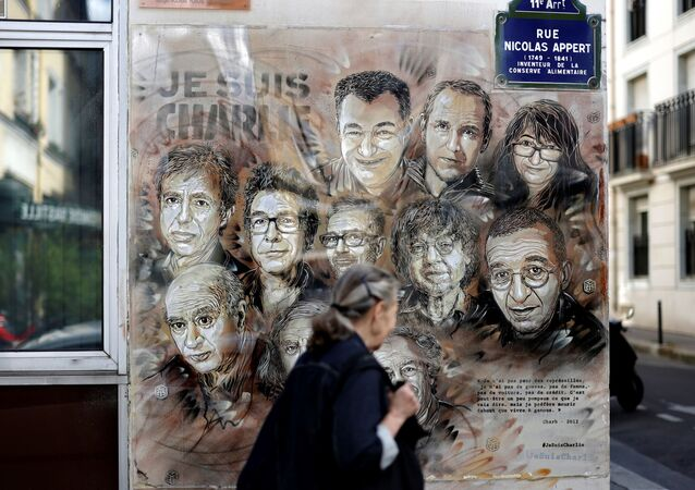 A woman walks past a painting by French street artist and painter Christian Guemy, known as C215, in tribute to members of Charlie Hebdo newspaper who were killed by jihadist gunmen in January 2015, in Paris, on August 31, 2020. - Fourteen alleged accomplices in the 2015 jihadist attacks on the Charlie Hebdo satirical weekly, on a kosher supermarket and in the southern Paris suburb Montrouge go on trial on September 2, more than half-a-decade after days of bloodshed that still shock France. The attacks heralded a wave of Islamist violence that has left 258 people dead and raised unsettling questions about modern France's ability to preserve security and harmony for a multicultural society.