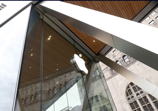 This photo shows an Apple logo on the facade of the downtown Brooklyn Apple store in New York on Saturday, March 14, 2020
