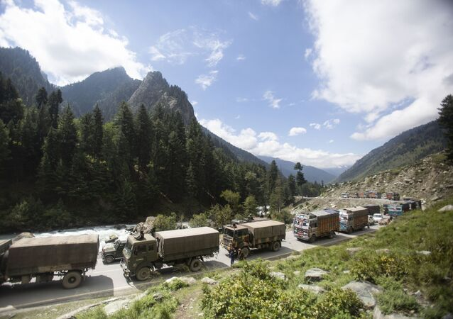 An Indian army convoy moves on the Srinagar- Ladakh highway at Gagangeer, northeast of Srinagar, Indian-controlled Kashmir, Tuesday, Sept. 1, 2020