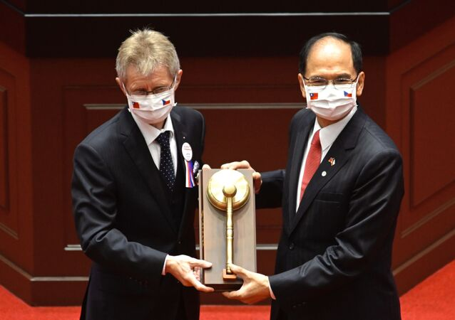 Czech Senate speaker Milos Vystrcil (L) receives a gavel from Taiwan's parliament speaker Yu Shyi-ku during a ceremony at the parliament in Taipei on September 1, 2020.