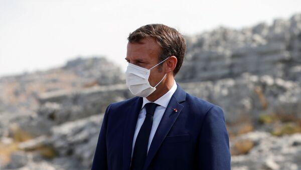 French President Emmanuel Macron attends a ceremony to plant a cedar with members of the NGO Jouzour Loubnan in Jaj, near Beirut, Lebanon September 1, 2020 - Sputnik International