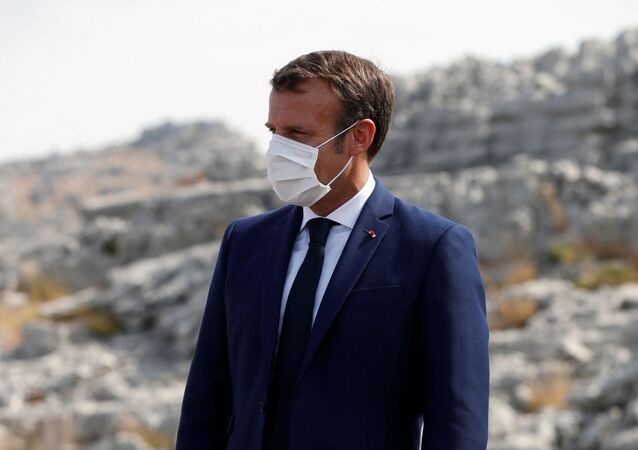 French President Emmanuel Macron attends a ceremony to plant a cedar with members of the NGO Jouzour Loubnan in Jaj, near Beirut, Lebanon September 1, 2020