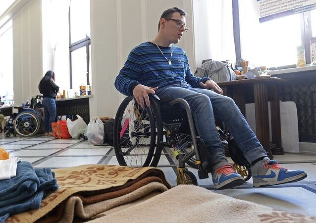 Parents and their disabled children wait for the next round of talks with government officials in Poland