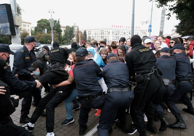 Students scuffle with law enforcement officers during a protest against presidential election results in Minsk, Belarus September 1, 2020