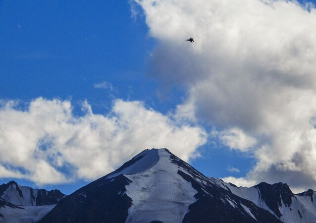 An Indian fighter jet flies over a mountain range in Leh, the joint capital of the union territory of Ladakh, on August 31, 2020.