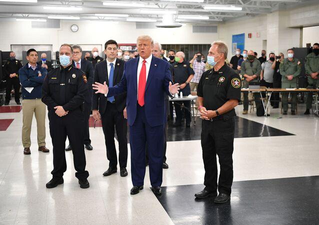 US President Donald Trump speaks with officials on September 1, 2020, at Mary D. Bradford High School in Kenosha, Wisconsin.