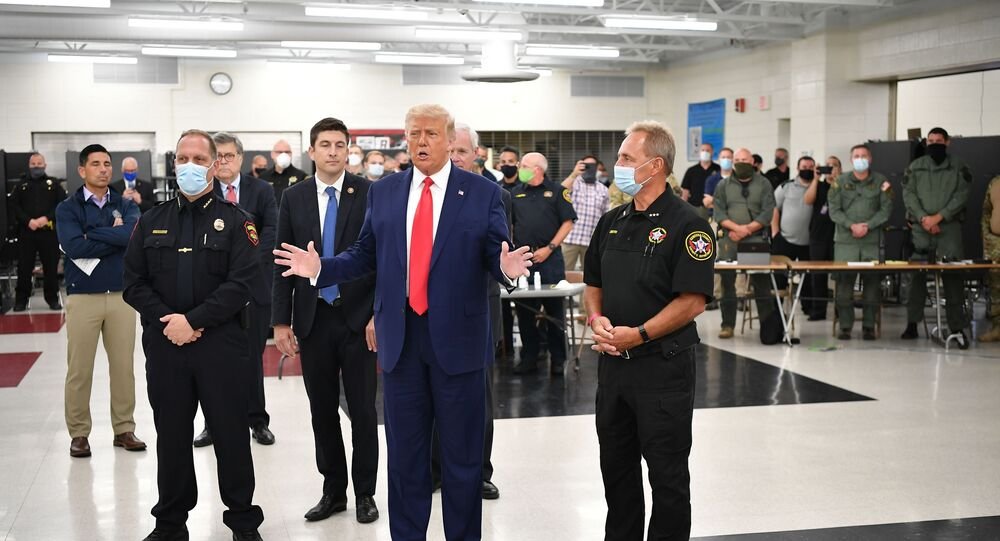 US President Donald Trump speaks with officials on September 1, 2020, at Mary D. Bradford High School in Kenosha, Wisconsin.