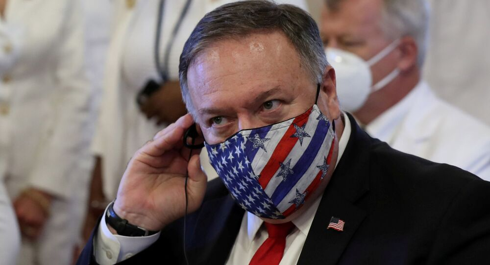 U.S. Secretary of State Mike Pompeo adjusts his earphones during a Te Deum as part of the swearing-in ceremony of Dominican Republic's new President Luis Abinader in Santo Domingo, Dominican Republic August 16, 2020