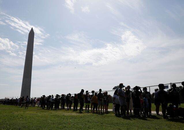 People line up in front of the Washington Monument before the Get Your Knee Off Our Necks march in support of racial justice that is expected to gather protestors from all over the country in Washington, U.S., August 28, 2020.