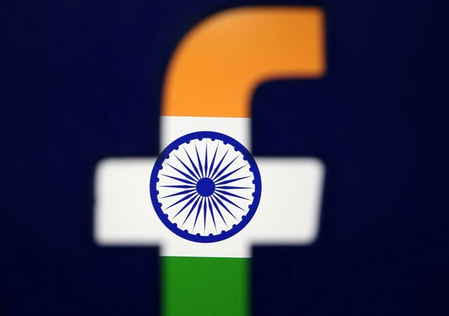 India's flag is seen through a 3D-printed Facebook logo in this illustration picture, 8 April 2019