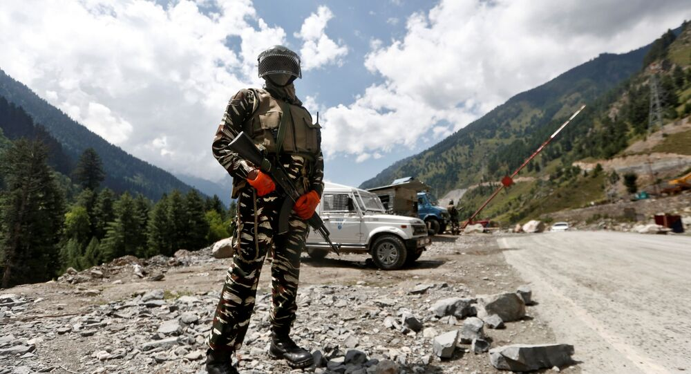 An Indian Central Reserve Police Force (CRPF) personnel stands guard at a checkpoint along a highway leading to Ladakh, at Gagangeer in Kashmir's Ganderbal district September 2, 2020