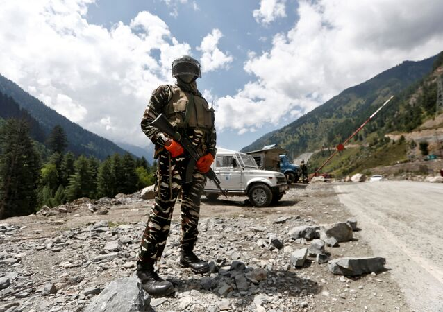 A member of the Indian Central Reserve Police Force (CRPF) stands guard at a checkpoint along a highway leading to Ladakh, at Gagangeer in Kashmir's Ganderbal district 2 September 2020