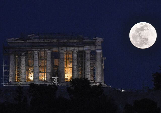 The Super Snow Moon rises next to the Parthenon Temple at the Acropolis archaeological site on February 19, 2019.