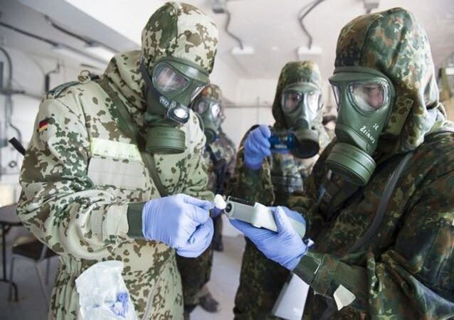 German Bundeswehr soldiers from the CBRN (Chemical Biological Radiological Nuclear) Defence Battalion 750 use a chemical agent detector to identify a simulated chemical weapon agent. File photo.
