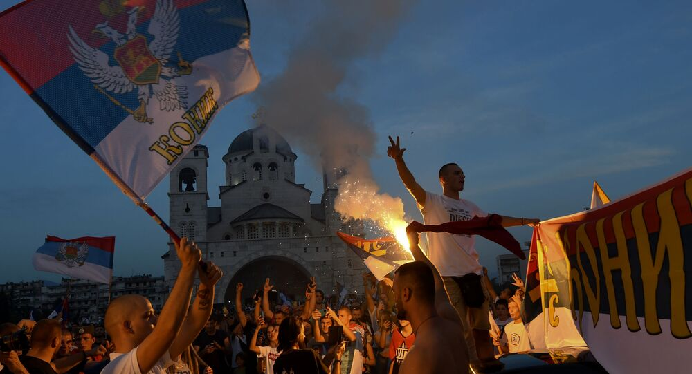 Opposition supporters celebrate on the streets after the general elections in Podgorica, Montenegro, on August 31, 2020. - Montenegro's pro-West ruling party could be knocked from power for the first time in three decades after an election gave a razor-thin edge to opposition camps, results showed on August 31, 2020. The Democratic Party of Socialists (DPS) led by President Milo Djukanovic is still the biggest party after winning just over third of the vote, according to official results from Sunday's election.