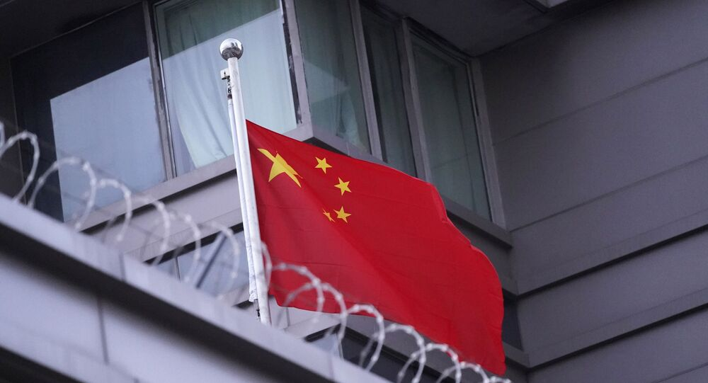 The flag of China flies outside the Chinese Consulate Wednesday, July 22, 2020, in Houston.