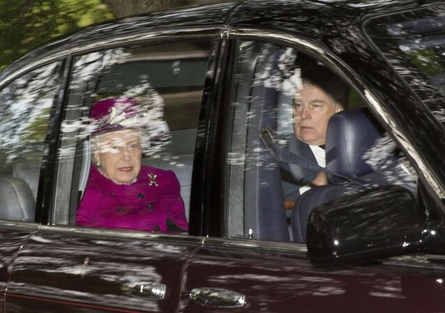 Britain's Queen Elizabeth arrives with her son Prince Andrew, at Crathie Kirk to attend a Sunday morning church service near Balmoral, Scotland, Sunday, Sept. 15, 2019.