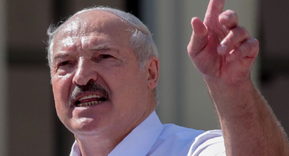 Belarus' President Alexander Lukashenko delivers a speech during a rally held to support him in central Minsk, on August 16, 2020.