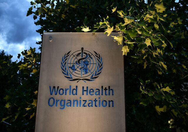 A photo taken in the late hours of August 17, 2020 shows a sign of the World Health Organization (WHO) at their headquarters in Geneva amid the COVID-19 outbreak, caused by the novel coronavirus.