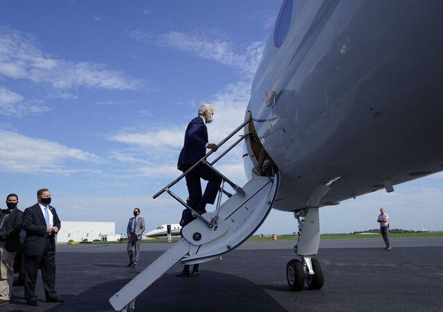 Democratic presidential candidate and former Vice President Joe Biden boards a plane en route to Kenosha, Wisconsin.